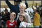 Lynne Cheney poses for photos with children at George Washington's Mount Vernon Estate, Friday, Sept. 16, 2005 in Mount Vernon, Va., during the Constitution Day 2005: Telling America's Story event. White House photo by Shealah Craighead