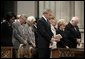 President George W. Bush bows his head in prayer during the National Day of Prayer and Remembrance Service at the Washington National Cathedral in Washington, D.C., Friday, Sept. 16, 2005. Also pictured are Laura Bush, Lynne Cheney Vice President Cheney, Secretary Rice and Secretary Rumsfeld. White House photo by Eric Draper