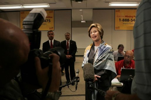 Laura Bush talks with the press during her visit to the National Center for Missing & Exploited Children in Alexandria, Va., Friday, Sept. 16, 2005. White House photo by Krisanne Johnson