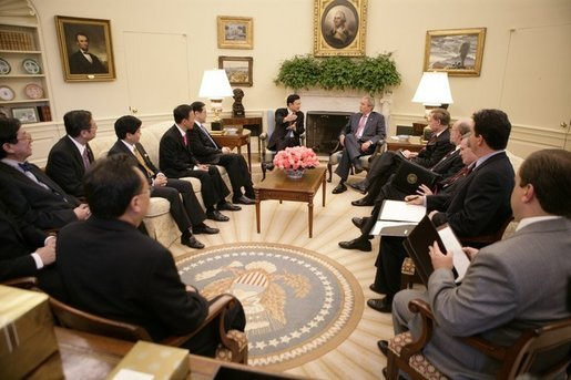 President George W. Bush meets with Thailand's Prime Minister Thaksin Shinawatra, during a visit to the Oval Office at the White House, Monday, Sept. 19, 2005 in Washington. White House photo by Eric Draper