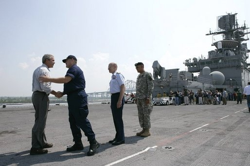 President George W. Bush is greeted by U.S. Coast Guard Vice Admiral Thad Allen, Tuesday, Sept. 20, 2005 aboard the USS Iwo Jima in New Orleans, La., joined by Rear Admiral Robert Duncan and U.S. Army Lt. General Russel Honore, right. White House photo by Eric Draper