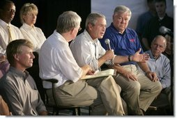 President George W. Bush speaks during a meeting with local officials and business leaders, including Mississippi Governor Haley Barbour, right, in Gulfport, Miss., Tuesday, Sept. 20, 2005.  White House photo by Eric Draper