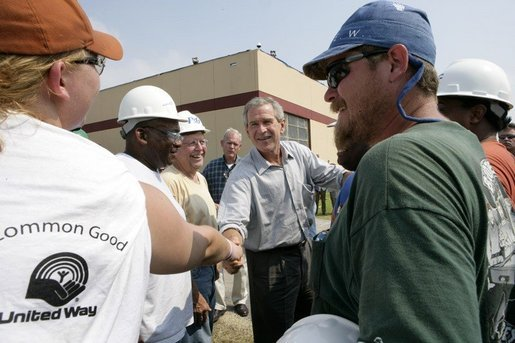 President George W. Bush greets construction workers outside the Folgers Coffee plant in in New Orleans, La., Tuesday, Sept. 20, 2005. White House photo by Eric Draper