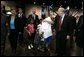 "Laura Bush is greeted by three youngsters upon her arrival Monday, Sept. 19, 2005, to ""Operation Compassion"" at George R. Brown Convention Center in Houston. White House photo by Krisanne Johnson"