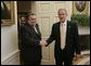 President George W. Bush welcomes Hajim al-Hasani, the Speaker of Iraq's Transitional National Assembly, into the Oval Office, Wednesday, Sept. 21, 2005 at the White House in Washington. White House photo by Paul Morse