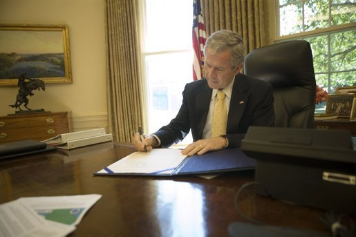 "President George W. Bush signs into law H.R. 3169, the ""Pell Grant Hurricane and Disaster Relief Act,"" which authorizes the Department of Education to waive requirements for Pell Grant repayments if student withdrawals from institutions of higher education are due to major disasters, Wednesday, Sept. 21, 2005, in the Oval Office. The President also signed into law two other hurricane-related bills: H.R. 3668, the ""Student Grant Hurricane and Disaster Relief Act,"" and H.R. 3672, the ""TANF Emergency Response and Recovery Act of 2005."" White House photo by Eric Draper"