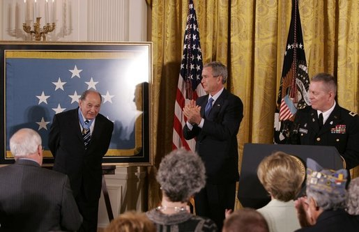 "Korean War era veteran Corporal Tibor ""Ted"" Rubin, receives a standing ovation, after being presented the Medal of Honor by President George W. Bush, Friday, Sept. 23, 2005 at cermonies at the White House in Washington. Rubin was honored for his actions under fire, and his bravery while in captivity at a Chinese POW camp. White House photo by Krisanne Johnson"