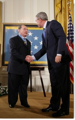 "President George W. Bush congratulates Korean War era veteran Corporal Tibor "" Ted"" Rubin, after awarding Rubin the Medal of Honor, Friday, Sept. 23, 2005 at cermonies at the White House in Washington. Rubin was honored for his actions under fire, and his bravery while in captivity at a Chinese POW camp.  White House photo by Paul Morse"