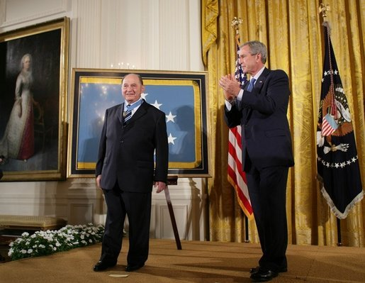 "President George W. Bush applauds Korean War era veteran Corporal Tibor ""Ted"" Rubin, after awarding Rubin the Medal of Honor, Friday, Sept. 23, 2005 at cermonies at the White House in Washington. Rubin was honored for his actions under fire, and his bravery while in captivity at a Chinese POW camp. White House photo by Paul Morse"