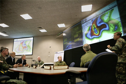President George W. Bush receives a briefing on Hurricane Rita Friday, Sept. 23, 2005 inside NORAD's U.S. Northern Command at Peterson Air Force Base in Colorado Springs, Colorado. White House photo by Eric Draper