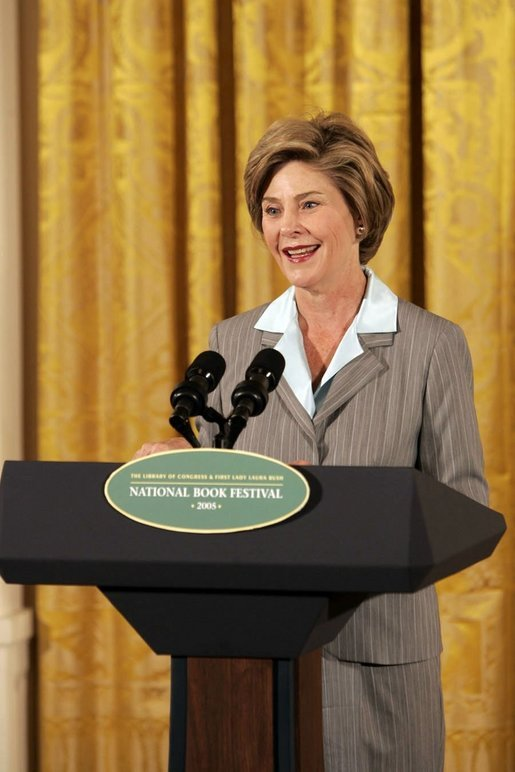 "Laura Bush speaks at the National Book Festival Author's breakfast in the East Room, Saturday, Sept. 24, 2005. ""Great books have brought many people through difficult times,"" said Mrs. Bush, explaining that the Book Festival is collecting books for schools, libraries and those affected by the recent hurricanes. ""A story's setting -- real or imagined -- can provide a much-needed escape. And the characters in a good book are like old friends by the time we turn the final page."" White House photo by Krisanne Johnson"