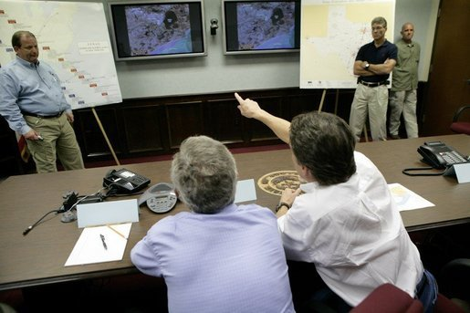 President George W. Bush and Texas Governor Rick Perry, right, participate in a meeting with Texas officials inside the Texas Emergency Operations Center in Austin, Texas, Saturday, Sept. 24, 2005. White House photo by Eric Draper