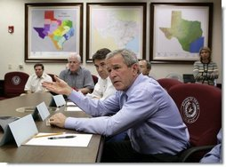 President George W. Bush speaks during a meeting with Texas officials, including Texas Governor Rick Perry, left, inside the Texas Emergency Operations Center in Austin, Texas, Saturday, Sept. 24, 2005. White House photo by Eric Draper