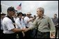 President George W. Bush greets members of the Ohio Urban Search and Rescue Unit during his visit Tuesday, Sept. 27, 2005 to Lake Charles, La. It was the President's seventh visit to the Gulf Coast area since Hurricane Katrina. White House photo by Eric Draper
