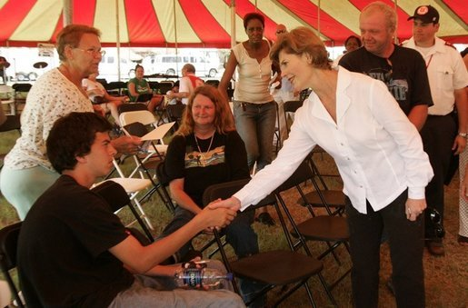 Laura Bush meets with people while visiting a medical and food distribution site, Tuesday, Sept. 27, 2005 in Biloxi, Miss. White House photo by Krisanne Johnson