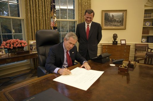 President George W. Bush signs the commission appointing John Roberts as the 17th Chief Justice of the United States prior to swearing-in ceremonies Thursday, Sept. 29, 2005, at the White House. White House photo by Eric Draper