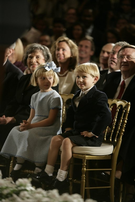 Jack and Josie Roberts look on as their father, John G. Roberts Jr., takes the Oath of Office as the 17th Chief Justice of the United States during ceremonies Thursday, Sept. 29, 2005, at the White House. White House photo by Eric Draper