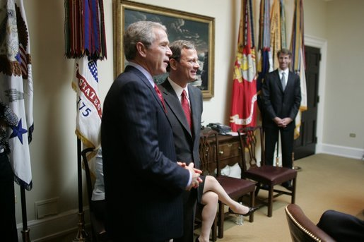 President George W. Bush stands in the Roosevelt Room of the White House with Judge John Roberts Thursday, Sept. 29, 2005, after the Senate vote confirming Judge Roberts as the 17th Chief Justice of the United States was announced on television. White House photo by Paul Morse