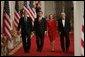 President George W. Bush walks with Judge John Roberts, his wife, Jane Marie Sullivan Roberts, and Associate Justice John Paul Stevens to the East Room of the White House Thursday, Sept. 29, 2005, where Judge Roberts was sworn in as Chief Justice of the United States. White House photo by Paul Morse