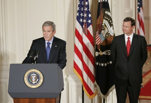 With Chief Justice John Roberts looking on, President George W. Bush makes remarks Thursday, Sept. 29, 2005, after the swearing-in ceremony in the East Room of the White House. Justice Roberts was confirmed earlier in the day by a 78-22 Senate vote. White House photo by Paul Morse