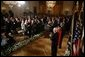 Chief Justice John G. Roberts receives a standing-ovation after he is sworn-in as the 17th Chief Justice of the United States, Thursday, Sept. 29, 2005 in the East Room of the White House in Washington. Chief Justice Roberts is applauded by President George W. Bush and fellow judges of the U.S. Supreme Court. White House photo by Paul Morse