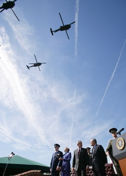 President George W. Bush stands with Defense Secretary Donald Rumsfeld during a helicopter flyover Friday, Sept. 30, 2005, during The Armed Forces Farewell Tribute in Honor of General Richard B. Myers and the Armed Forces Hail in Honor of General Peter Pace at Fort Myer's Summerall Field in Ft. Myer, Va. White House photo by Paul Morse