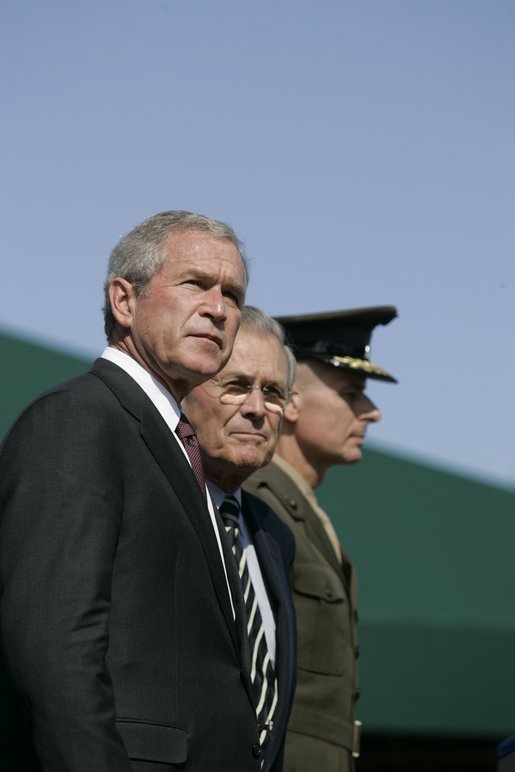 President George W. Bush stands with Defense Secretary Donald Rumsfeld during a helicopter flyover Friday, Sept. 30, 2005, during The Armed Forces Farewell Tribute in Honor of General Richard B. Myers and the Armed Forces Hail in Honor of General Peter Pace at Fort Myer, at Summerall Field in Ft. Myer, Va. White House photo by Shealah Craighead