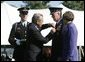 Defense Secretary Donald Rumsfeld pins a medal on General Richard B Myers, as Myers' wife, Mary Jo Myers, looks on Friday, Sept. 30, 2005, during The Armed Forces Farewell Tribute in Honor of General Richard B. Myers and the Armed Forces Hail in Honor of General Peter Pace at Fort Myer's Summerall Field in Ft. Myer, Va. White House photo by David Bohrer