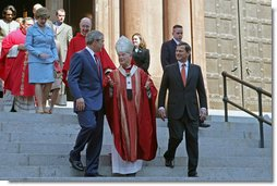 President George Bush walks out of St. Matthew's Cathedral with Theodore Cardinal McCarrick and Supreme Court Chief Justice John Roberts after attending the 52nd Annual Red Mass in Washington, DC, Sunday, October 2, 2005. The Red Mass, a historical tradition within the Catholic Church, is held on the Sunday before the opening session of the Supreme Court. White House photo by Shealah Craighead