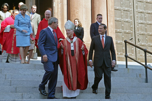 President George Bush walks out of St. Matthew's Cathedral with Cardinal Theodore McCarrick and Supreme Court Chief Justice John Roberts after attending the 52nd Annual Red Mass in Washington, DC, Sunday, October 2, 2005. The Red Mass, a historical tradition within the Catholic Church, is held on the Sunday before the opening session of the Supreme Court. White House photo by Shealah Craighead