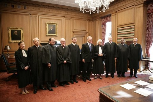 President George W. Bush stands with U.S. Supreme Court Chief Justice John Roberts, as they pose for photos with U.S. Supreme Court Associate Justices, from left to right, Justice Ruth Bader Ginsburg, Justice David H. Souter, Justice Anthonin Scalia, Justice John Paul Stevens, Justice Sandra Day O'Connor, Justice Anthony Kennedy, Justice Clarence Thomas and Justice Stephen G. Breyer, during the investiture ceremony for Chief Justice Roberts, Monday, Oct. 3, 2005 at the Supreme Court in Washington. White House photo by Eric Draper