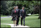 Harriet Miers escorts Supreme Court Associate Justice nominee John G. Roberts Jr. along the South Lawn sidewalk en route to the Oval Office to meet with President George W. Bush July 19, 2005. White House photo by Eric Draper