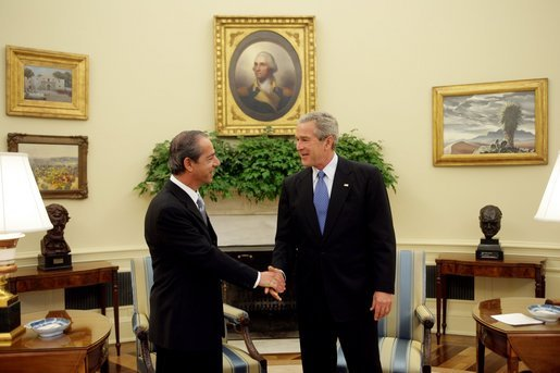 President George W. Bush welcomes Dr. Lawrence Gonzi, Prime Minister of Malta, to the Oval Office Monday, Oct. 3, 2005. White House photo by Paul Morse