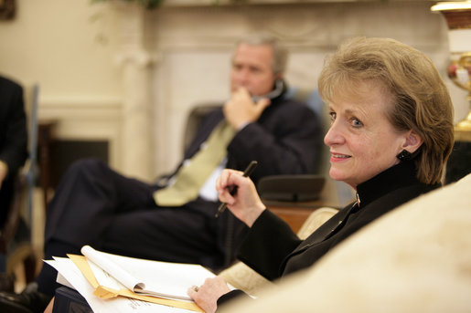 White House Counsel Harriet Miers sits in the Oval Office July 1, 2005, as President George W. Bush speaks on the phone in the background. White House photo by Eric Draper