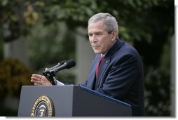 President George W. Bush responds to a question during Tuesday's news conference in the Rose Garden of the White House.  White House photo by Eric Draper