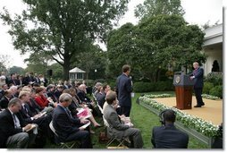 President George W. Bush listens to a question from the media Tuesday, Oct. 4, 2005, during a news conference in the Rose Garden. Before taking questions, the President spoke briefly on his Supreme Court nomination of Harriet Miers and the continuing cleanup and reconstruction effort in the wake of hurricanes Katrina and Rita.  White House photo by Eric Draper