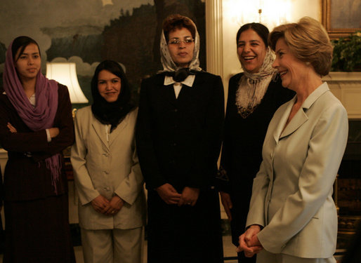 Laura Bush meets with a group of Afghan teachers Wednesday, Oct. 5, 2005, who are training at the University of Nebraska in Omaha on an educational exchange sponsored by the U.S. Department of State's Bureau of Educational and Cultural Affairs and the U.S.-Afghan Women's Council. White House photo by Krisanne Johnson