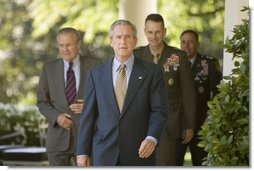 President George W. Bush walks to the Rose Garden Wednesday, Oct. 5, 2005, followed by Secretary of Defense Donald Rumsfeld, General Peter Pace, Chairman of the Joint Chiefs of Staff, and Gen. David Petraeus, former Commander of the Multinational Security and Transition Team in Iraq.  White House photo by Paul Morse