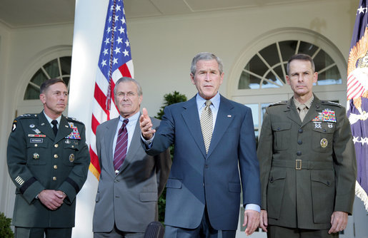 President George W. Bush addresses the media Wednesday, Oct. 5, 2005, in the Rose Garden, flanked by Gen. David Petraeus, former Commander of the Multinational Security and Transition Team in Iraq; Secretary of Defense Donald Rumsfeld, and Gen. Peter Pace, Chairman of the Joint Chiefs of Staff. White House photo by Paul Morse
