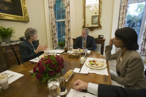President George W. Bush is joined for lunch Wednesday, Oct. 5, 2005, by Secretary of State Dr. Condoleezza Rice and Karen Hughes, newly appointed Under Secretary of State for Public Diplomacy and Public Affairs. White House photo by Eric Draper