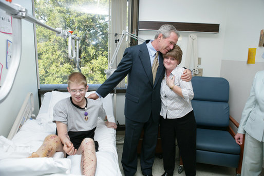 President George W. Bush hugs Anita Kukkola, the mother of PFC. Jason Kukkola of Fountain Hills, Ariz., Wednesday, Oct. 5, 2005, after he presented the soldier with a Purple Heart during a visit to Walter Reed Army Medical Center in Washington D.C. White House photo by Paul Morse