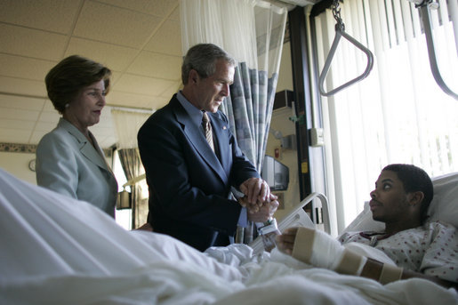 President George W. Bush and Mrs. Laura Bush talk with Sgt. Patrick Hagood of Anderson, S.C., Wednesday, Oct. 5, 2005, during their visit to Walter Reed Army Medical Center in Washington D.C. White House photo by Paul Morse