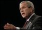 President George W. Bush addresses his remarks on the War on Terror, Thursday, Oct. 6, 2005, speaking before the National Endowment for Democracy at the Ronald Reagan Building and International Trade Center in Washington. White House photo by Eric Draper