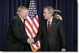 President George W. Bush shakes hands with William F. Buckley, Jr., Thursday, Oct. 6, 2005 at the Eisenhower Executive Office Building in Washington, to honor the 50th anniversary of National Review magazine, which was founded by Buckley, and to recognize Buckley's upcoming 80th birthday.  White House photo by Paul Morse