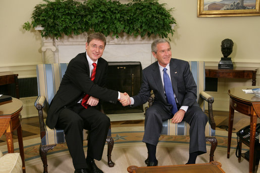 "President George W. Bush and Prime Minister Ferenc Gyurcsany of Hungary shake hands during a photo opportunity in the Oval Office of the White House Friday, Oct. 7, 2005. The President told the media he appreciated the Prime Minister's understanding of the ""importance of democracy and freedom,"" and thanked him for his leadership. White House photo by Paul Morse"