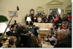 The media gathers around President George W. Bush and Prime Minister Ferenc Gyurcsany of Hungary during their photo opportunity in the Oval Office Friday, Oct. 7, 2005. White House photo by Paul Morse