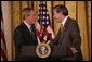 President George W. Bush thanks U.S. Commerce Secretary Carlos Gutierrez for his introduction in the East Room of the White House, Friday, Oct. 7, 2005, as President Bush prepares to address remarks in celebration of Hispanic Heritage Month. President Bush also honored recipients of the President's Volunteer Service Awards at the event. White House photo by Eric Draper