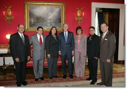 "President George W. Bush poses for a photo in the Red Room of the White House, Friday, Oct. 7, 2005, with recipients of the President's Volunteer Service Awards, honored in celebration of Hispanic Heritage Month. From left to right with President Bush are John Diaz of Crowley, Colo., Manuel Fonseca of Nashville, Tenn., Marie Arcos of Houston Texas, Maria Hines of Albuquerque, N.M., Eleuterio ""Junior"" Salazar of Bradenton, Fla. and Dr. Elmer Carreno of Silver Spring, Md.  White House photo by Shealah Craighead"