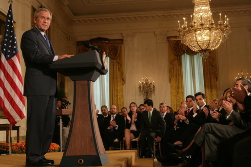 President George W. Bush is applauded in the East Room of the White House, Friday, Oct. 7, 2005, as he offers remarks in celebration of Hispanic Heritage Month. President Bush also honored recipients of the President's Volunteer Service Awards at the event. White House photo by Shealah Craighead