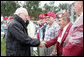 "Vice President Dick Cheney shakes hands with veterans of the 526th Armored Infantry Battalion Friday, Oct. 7, 2005, after delivering remarks during a wreath-laying ceremony at the National World War II Memorial in Washington D.C. ""I count it a privilege to stand in the presence of men who were sent into battle by President Franklin D. Roosevelt.and who, by your courage and honor and devotion to duty, helped to win a war and change the course of history ,"" said the Vice President to the soldiers, widows and family members who attended the ceremony. The 526th AIB is the sole remaining, separate, armored infantry battalion from World War II whose soldiers defended the Belgian villages of Stavelot and Malmedy on December 16, 1944, the first day of the Battle of the Bulge. White House photo by David Bohrer"
